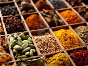 A variety of Indian spices in a wooden tray editorial food