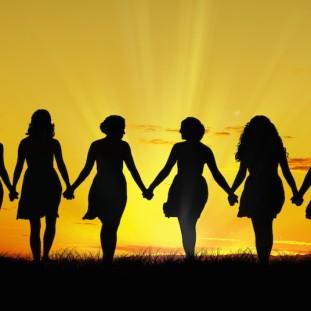 Women walking hand in hand